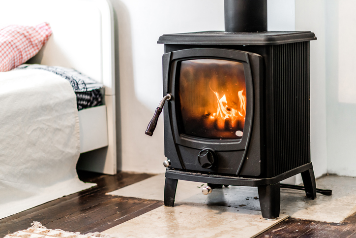 Wood burning stove in bedroom